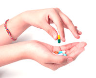 Hand holding drugs on white Royalty Free Stock Images
