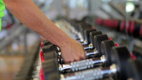 Hand holding dumbbell.Close up.Muscular arm in the stock footage
