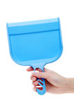 Hand holding dustpan Royalty Free Stock Photography