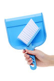 Hand holding dustpan Royalty Free Stock Image