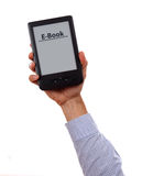 Hand holding e-book reader  on white background Royalty Free Stock Photo