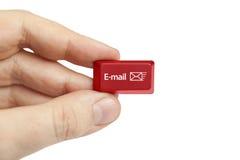 Hand holding e-mail computer key. Close-up photograph of hand holding e-mail computer key stock images