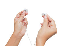 Hand holding earphone. Music and sond Royalty Free Stock Image