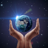 Hand holding earth. Stock Photos