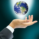 Hand holding earth Royalty Free Stock Images