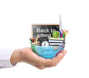 Hand holding earth and Education Stock Image