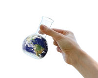 Hand holding the Earth in a flask royalty free stock photos