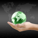 Hand holding the earth globe Stock Photo