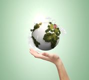Hand holding earth Stock Images