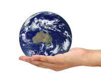 Hand holding Earth isolated on white background. Elements of thi Stock Image