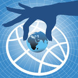 Hand holding Earth over globe symbol background Stock Photo