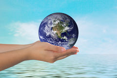 Hand holding earth sphere. Stock Photos
