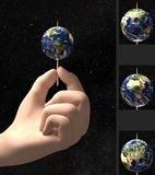 Hand holding Earth on toothpick Stock Photos
