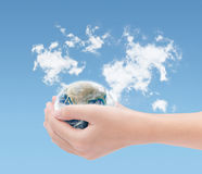 Hand holding earth on world clouds map background ,Elements of t. His image furnished by NASA royalty free stock images