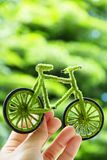 Hand Holding Eco bicycle icon. Energy concept Stock Images