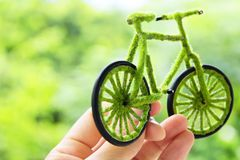 Hand Holding Eco bicycle icon concept Stock Photography