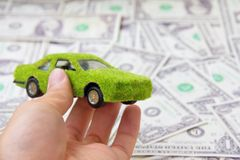 Hand Holding Eco car icon Royalty Free Stock Images