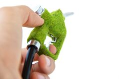 Hand holding eco fuel nozzle Stock Photography