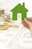 Hand holding eco house icon