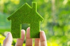Hand holding eco house icon. Concept Stock Photos