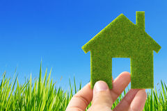 Hand holding eco house icon Royalty Free Stock Photo