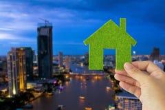 Hand holding eco house icon Royalty Free Stock Image