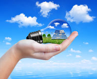 Hand holding eco light bulb Royalty Free Stock Image