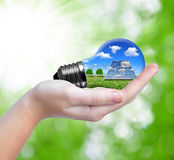 Hand holding eco light bulb Royalty Free Stock Image