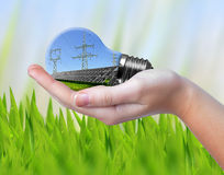 Hand holding eco light bulb. Green energy concept Stock Photography