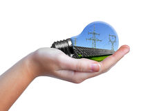 Hand holding eco light bulb Stock Photography