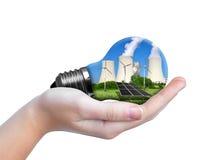 Hand holding eco lightbulb Stock Photography