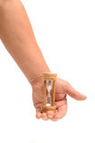 Hand holding egg timer Stock Images