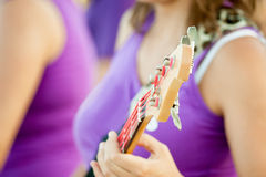 Hand holding an electric guitar deck on a concert Stock Image