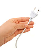 Hand holding electric plug. Stock Image