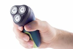 Hand holding electric shaver. Adainst white background Stock Images