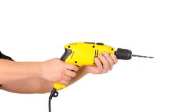 Hand holding electric yellow drill tool Stock Image