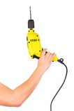 Hand holding electric yellow drill tool Royalty Free Stock Photos