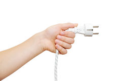 Hand holding electricity plug Royalty Free Stock Photos