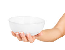 Hand holding an empty bowl Royalty Free Stock Image