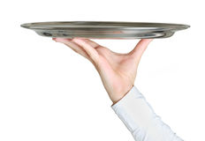 Hand holding empty dish Royalty Free Stock Photo