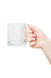 Hand holding empty glass. Hand holding empty transparent glass, isolated on white, clipping path Royalty Free Stock Image