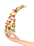 Hand holding an empty glass salad bowl Royalty Free Stock Photo