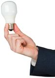 Hand holding energy saving light bulb Royalty Free Stock Image