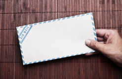 Hand holding  envelope. Royalty Free Stock Photography