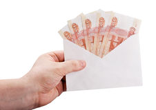 Hand holding an envelope with rubles Royalty Free Stock Photos