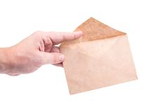 Hand holding envelopes with letters. On the white background isolated Royalty Free Stock Photos