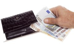 Hand holding a euro. Into wallet royalty free stock photography