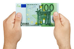 Hand Holding 100 euro banknote Isolated. Top view of male hands holding 100 euro banknote  isolated on white background Royalty Free Stock Photos