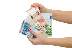 Hand holding Euro banknotes isolated Stock Photos