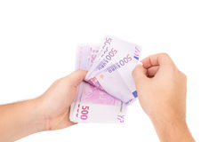 Hand holding euro banknotes. Stock Photo